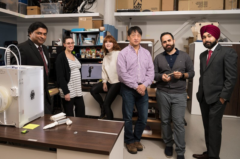 University of Delaware researchers are developing a medical device to help children with cerebral palsy. The device includes a novel artificial muscle that can assist when a child's own muscle power isn't enough to complete a movement. From left to right are  Joy Goswami, Elisa Arch, Martha Hall, Samuel Lee, Ahad Behboodi and Prabhpreet Gill.