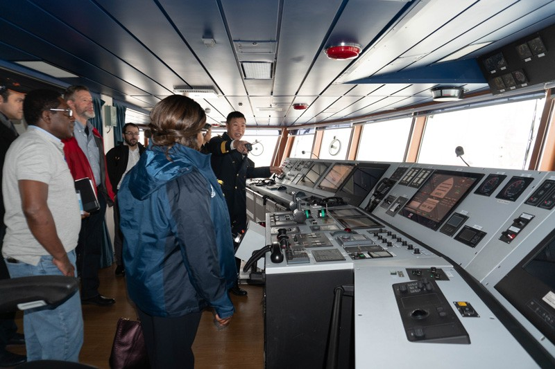 The captain of Xiamen University's Research Vessel Tan Kah Kee explained the bridge to CEOE Dean Estella Atekwana and other UD faculty touring the ship during a visit to Xiamen to renew the two universities' collaboration.