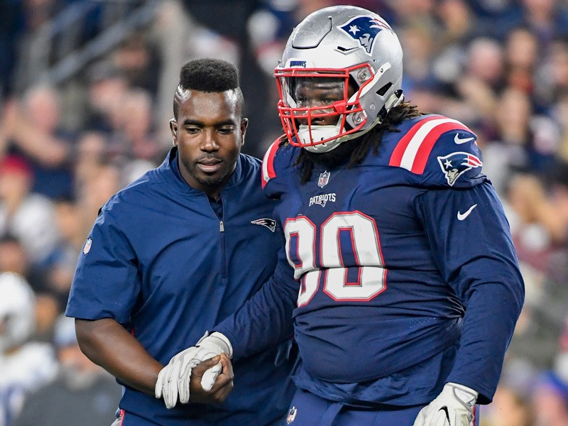 Mike Akinbola (left), who got his doctorate in physical therapy from UD in 2011, is an athletic trainer/physical therapist for the New England Patriots. This is his third Super Bowl with the team
