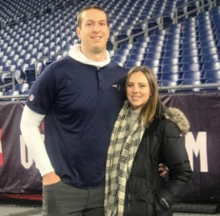 Shane Reybold, who got his doctorate in physical therapy in 2016, works as a seasonal physical therapist with the New England Patriots. In this photo, Reybold was joined on the field with his wife after a game this season.