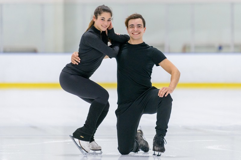 Mechanical engineering major Alannah Binotto and her ice dance partner Shiloh Judd pose on the ice of the Fred Rust Ice Rink on UD's campus.