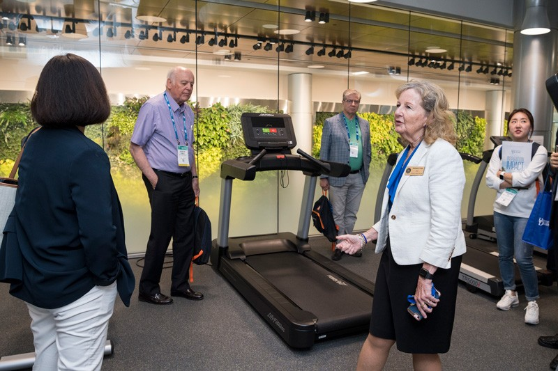 UD College of Health Sciences Dean Kathy Matt shows BIO 2019 visitors a physical therapy lab at STAR Campus.