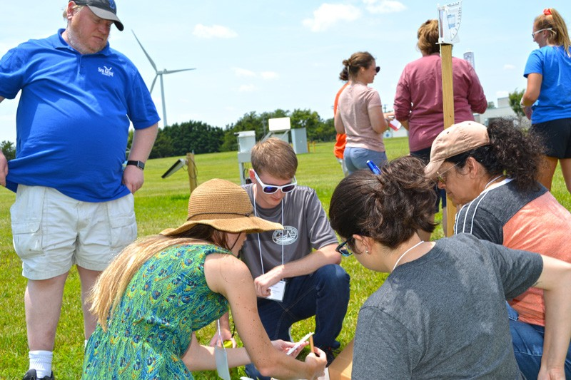 Delaware Sea Grant Education Specialist David Christopher (left) looks on as teachers practice taking weather measurements during the Climate Academy he taught with partners from the National Oceanic and Atmospheric Administration.