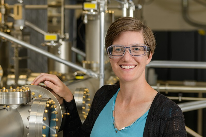 Stephanie Law, Clair Boothe Luce Assistant Professor in Materials Science and Engineering at the University of Delaware, has won a Presidential Early Career Award for Scientists and Engineers. She is standing next to the molecular beam epitaxy systems she uses in her award-winning research.