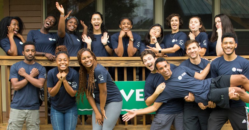 Nana Ohemaa Asante (back row third from left) poses with her Residence Life and Housing staff including supervisor Lillie Wilson (center) and mentor Emma Fink (back row third from right).
