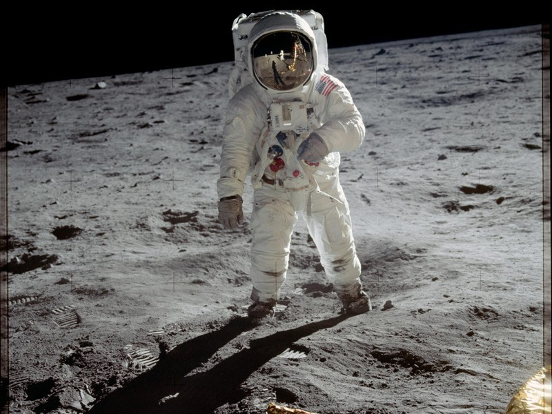 Astronaut Buzz Aldrin walks on the surface of the moon near the leg of the lunar module Eagle during the Apollo 11 mission. Mission commander Neil Armstrong took this photograph with a 70mm lunar surface camera. While astronauts Armstrong and Aldrin explored the Sea of Tranquility region of the moon, astronaut Michael Collin remained with the command module orbiting the moon.