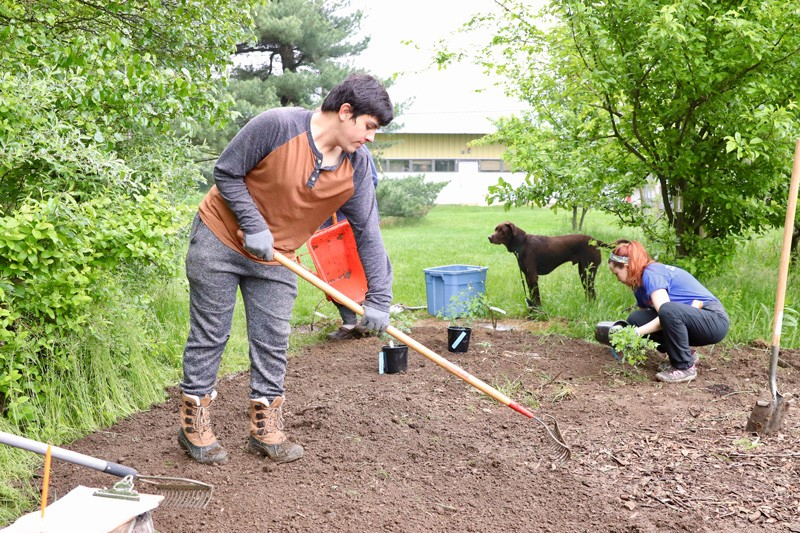 When drafting their landscape designs and installing plants in the edible forest garden, interns Eduardo Limon and Jenna Simons had to consider the myriad ways that children might experience the garden.