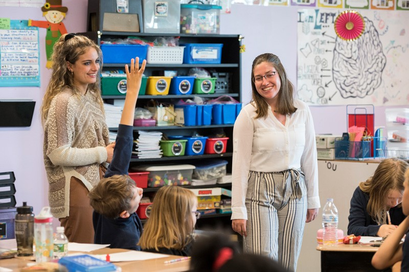 UD elementary teacher education majors Ashley Sullivan (left) and Briana Nolin student-teaching at Providence Creek Academy.