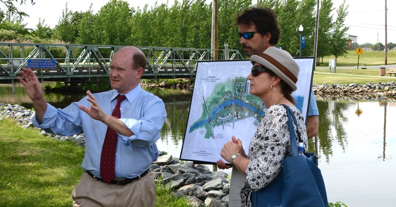 UD marine advisory service agent Ed Lewandowski (center) and landscape architecture professor Jules Bruck explain their vision for the town of Laurel to Delaware Senator Chris Coons (left).