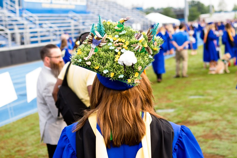 Susannah Halligan, a wildlife ecology and conservation major, decorated her cap with fake grass and birds.