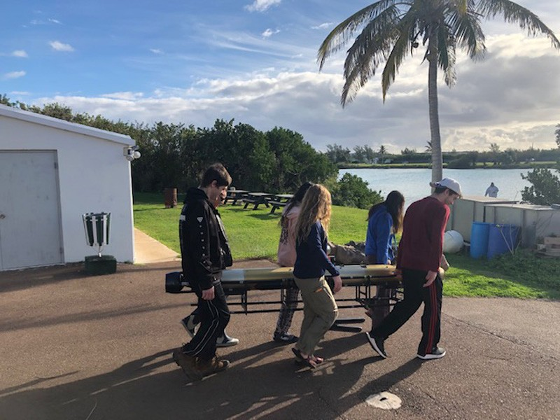UD students in the study abroad program carrying the AUV in Bermuda for a training mission.