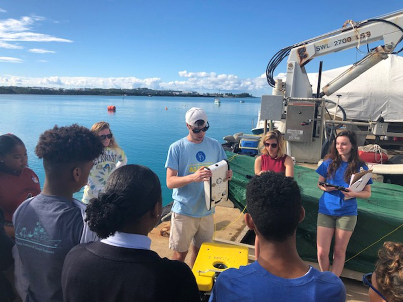 UD students teach Bermuda middle and high school students about how to use a UD remotely operated vehicle (ROV) underwater robot.