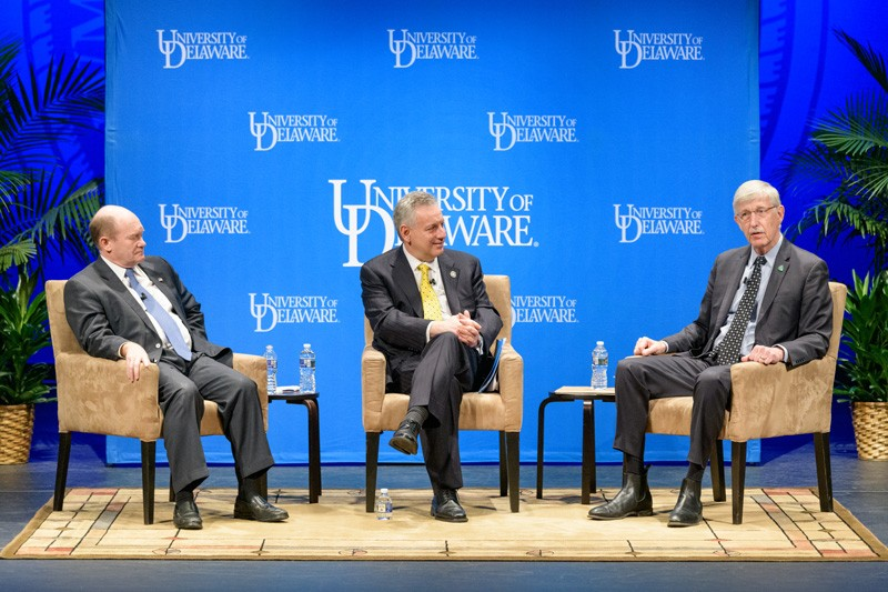 UD President Dennis Assanis (center) moderates a discussion between U.S. Sen. Chris Coons (left) and National Institutes of Health Director Francis Collins regarding research and healthcare in the United States and the rest of the world.