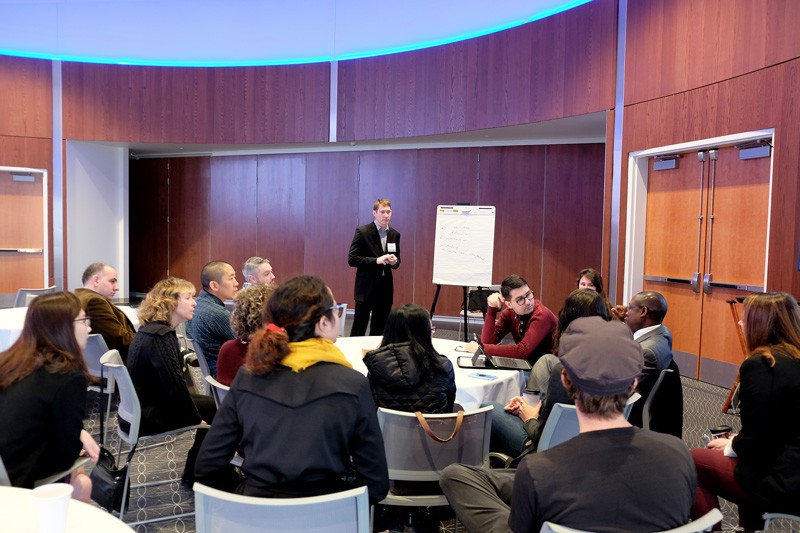Researchers, clinicians and graduate students gathered in small groups to discuss ways to strengthen neuroscience work. Here, Keith Schneider, director of the Center for Biomedical and Brain Imaging, leads a group focused on cognitive neuroscience.