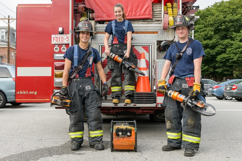 Matthew Heebner (left), Olivia Alexander (middle) and Connor Sproat (right) are UD students who volunteer with the Aetna Hose Hook and Ladder Company Station 9 in Newark.