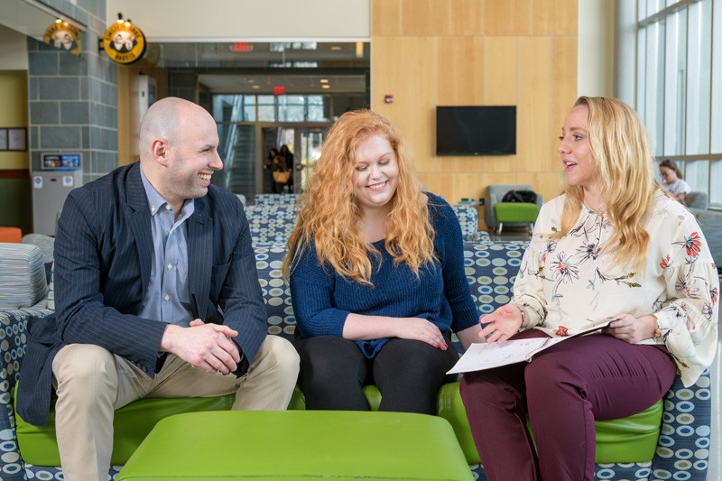 Joshua Wilson (left), assistant professor in the University of Delaware's School of Education, with undergraduate research assistants Mckenna Winnie and Ally Raiche.