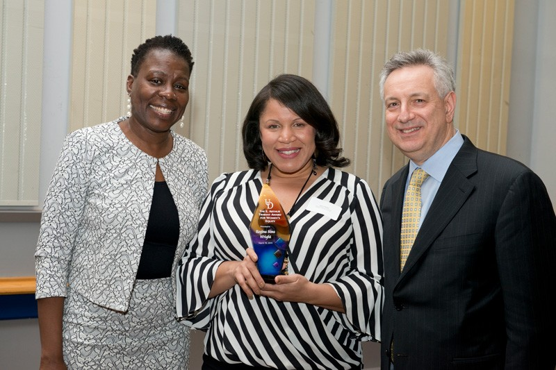 Flanked by UD Vice Provost for Diversity Carol Henderson (left) and UD President Dennis Assanis (right), Regina Sims Wright won the E. Arthur Trabant Award for Women's Equity at the 2019 Women of Promise dinner.
