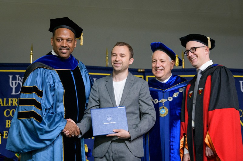 From left to right, Levi Thompson, dean of the College of Engineering; Alexander Mironenko (dissertation award winner); UD President Dennis Assanis; and Eric Furst, chair of the Department of Chemical and Biomolecular Engineering.