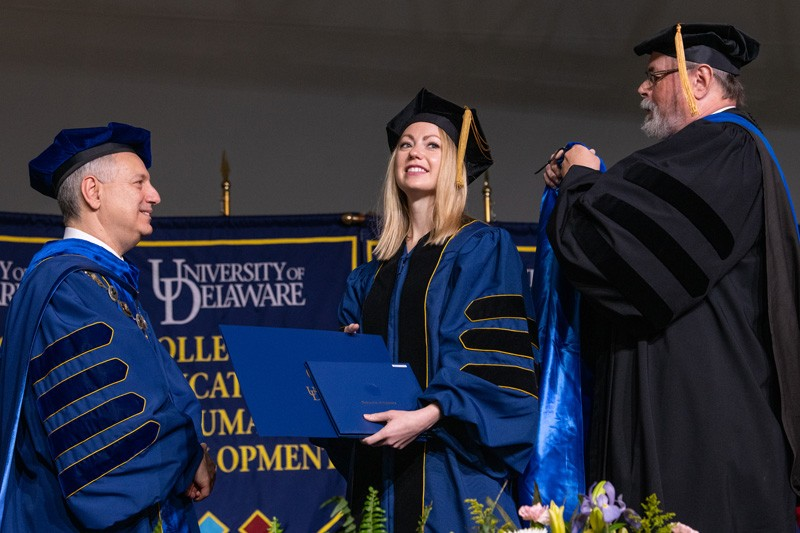 From left to right, UD President Assanis; Jessica Conrad, dissertation award winner; John Ernest, chair of the Department of English.