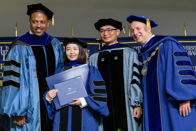 From left to right, Levi Thompson, dean of the College of Engineering; Mengvi Lv, a dissertation award winner; X. Lucas Lu, Lv's adviser and associate professor of mechanical engineering; and UD President Dennis Assanis.