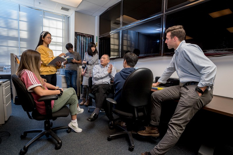 CEOE's Xiao-Hai Yan (second from right) meets with students in 2018. Estella Atekwana, dean of the College of Earth, Ocean and Environment, noted Yan's dedication as a mentor, particularly his efforts to foster his students' long-term career goals and to help them develop professional networks by attending national meetings and interacting with leading scientists.