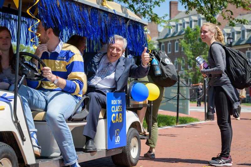University of Delaware President Dennis Assanis gives a thumbs up to students and friends of UD from the Class Cab during the second annual I Heart UD Giving Day on May 15, 2019.