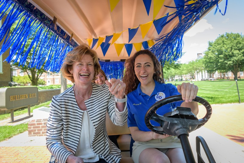 University of Delaware Provost Robin Morgan (left) waves to students and friends of UD from the Class Cab during the second annual I Heart UD Giving Day on May 15, 2019.