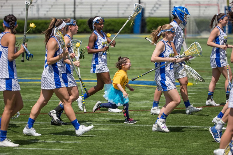 Hayden Weiss runs on the field with the UD women's lacrosse team.