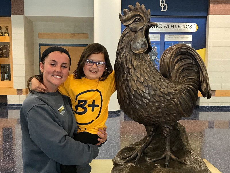 Maggie McCarthy, pal Hayden Weiss and their favorite Blue Hen (statue).