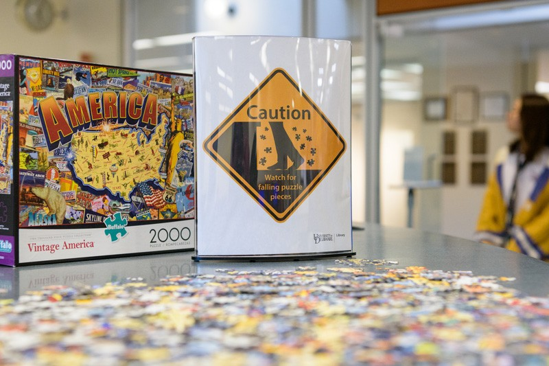 You might think puzzles are all fun and games, but missing pieces is actually an ongoing challenge. So much so that a sign was placed on the service desk to alert others.