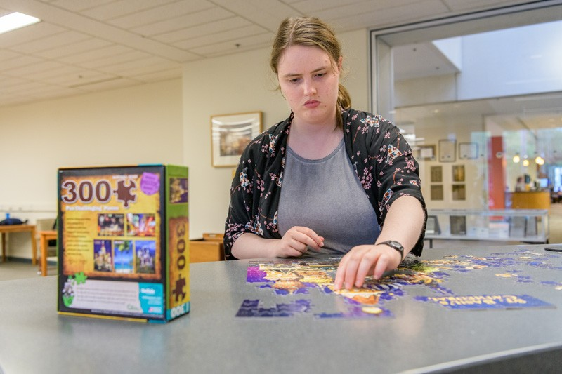 UD Senior Kate Whitcomb is a regular visitor of the puzzles. She is pictured above working on a 300-piece puzzle of St. Basil's Cathedral.