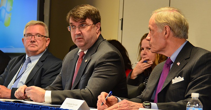 Vincent Kane (left), director of the Wilmington VA Medical Center, joins Secretary of Veterans Affairs Robert Wilkie (center), and Delaware U.S. Sen. Tom Carper during a recent visited UD to hear about the VA Patient Experience Academy.