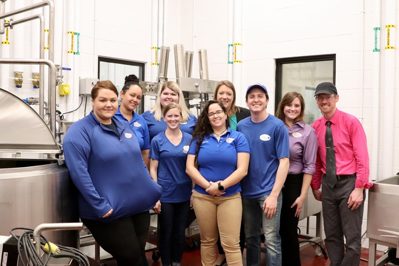 Several UDairy Creamery staff and student employees pose in the Genuardi Food Innovation Laboratory's cheese production room.