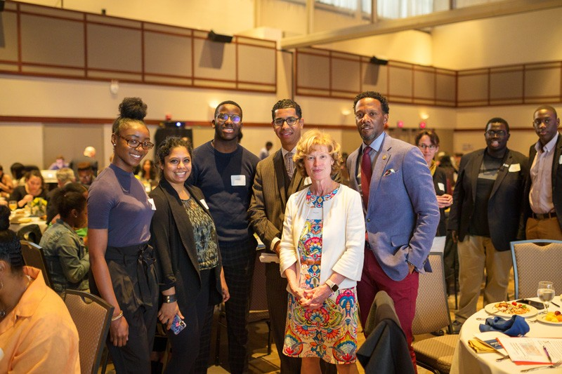 UD Provost Robin Morgan (fourth from left) stands with keynote speaker Wali Rushdan II and several of the 2019 Students of Distinction.