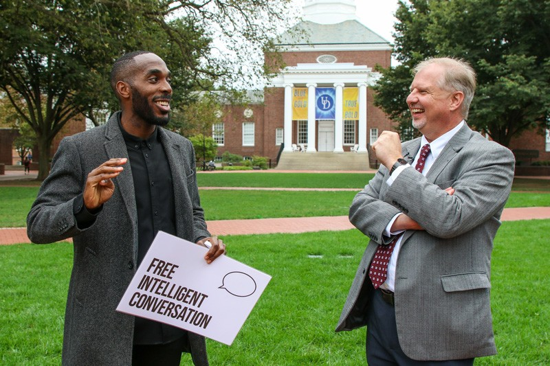 Kyle Emile (left), founder of the national Free Intelligent Conversation initiative, visits with College of Arts and Sciences Dean John A. Pelesko during a visit to UD in October.