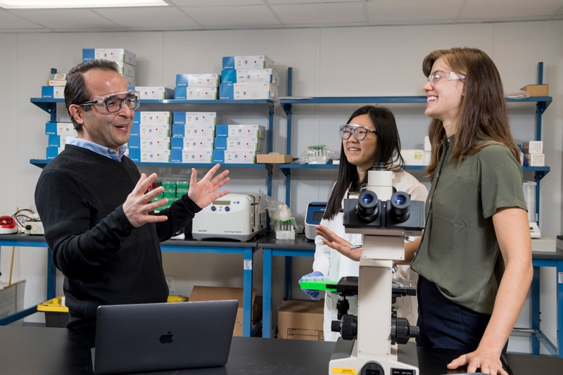 Behnam Abasht (center), UD associate professor of animal and food sciences, and UD doctoral students Juniper Lake (right) and Ziqing Wang, are working on wooden breast disease, a genetic problem affecting chickens.