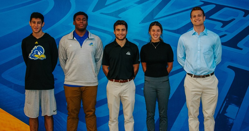 The inaugural class of Blue Hen Capstone Interns (above) is learning about the inner workings of the UD Athletic Department. Applications for the spring class open Oct. 15.