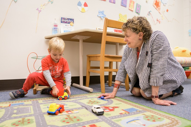 Roberta Michnick Golinkoff (right), Unidel H. Rodney Sharp Professor in the School of Education at the University of Delaware, meets with a child before his participation in learning experiments at the Child's Play, Learning and Development Laboratory.