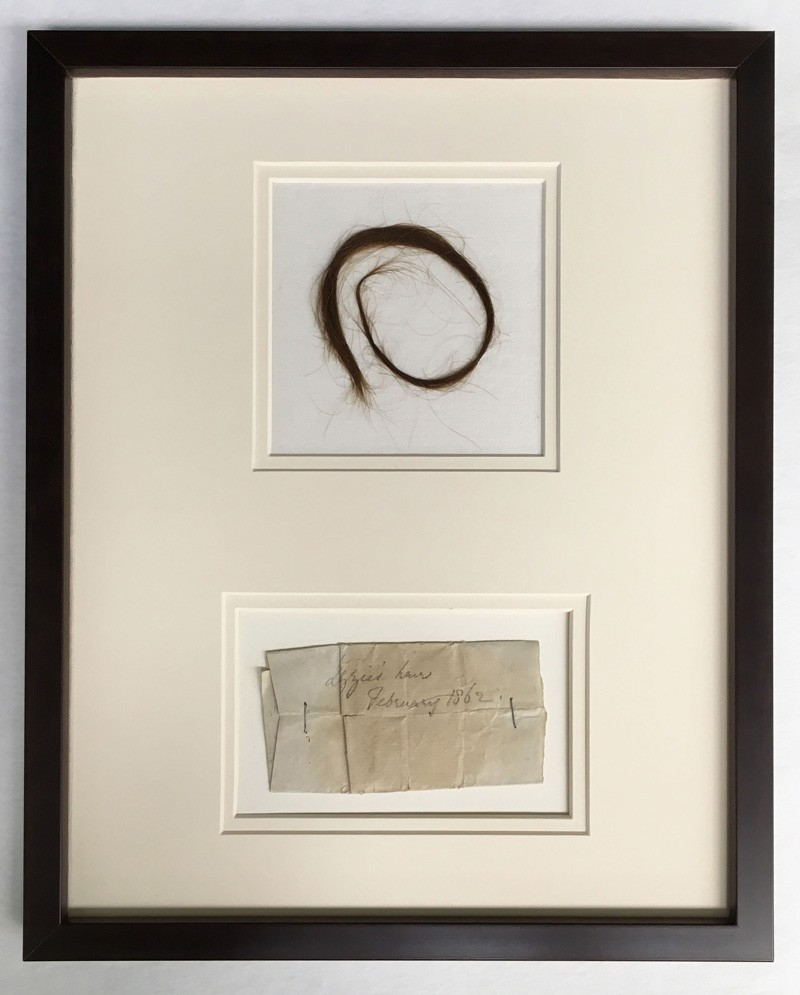 The lock of Lizzie, mounted and framed for display in London.