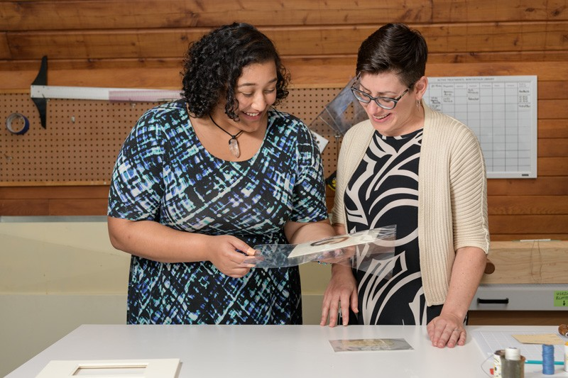 Layla Huff (left), a student intern from Morgan State University, worked under the supervision of Melissa Tedone, book and library conservator with the Winterthur/University of Delaware Program in Art Conservation, to prepare the hair for display in London.