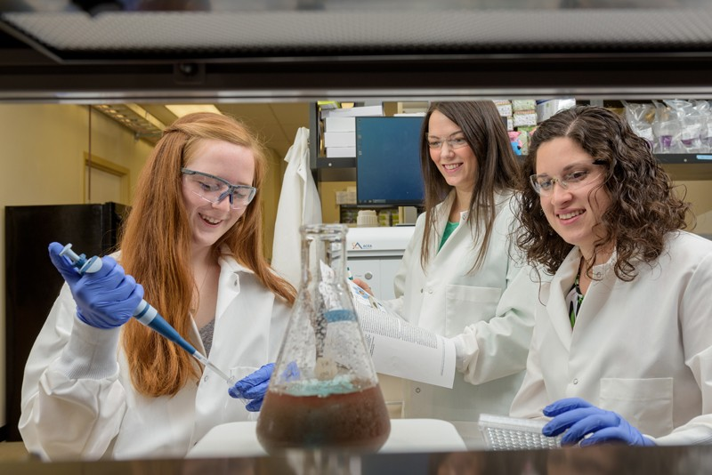 UD Engineering Prof. Emily Day (center) watches students Maggie Billingsley and Rachel Riley work in Day's lab.