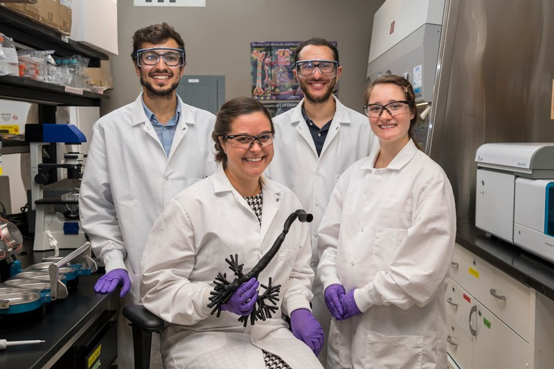 From left to right: doctoral student Bader Jarai, assistant professor Cathy Fromen, doctoral student Zach Stillman and doctoral student Emily Kolewe work to develop improved tools for pulmonary drug delivery testing, probe lung biology and immune function, and engineer novel therapeutics for controlled immune stimulation in the lung.