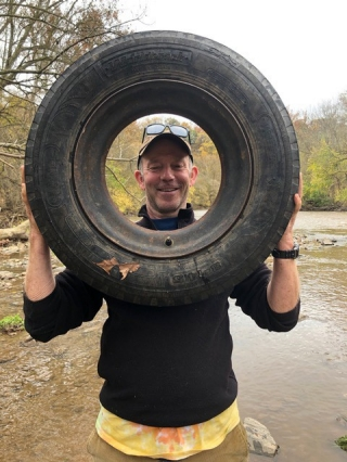 McKay Jenkins, Cornelius Tilghman Professor of English, Journalism and Environmental Humanities at the University of Delaware, holds up a tire