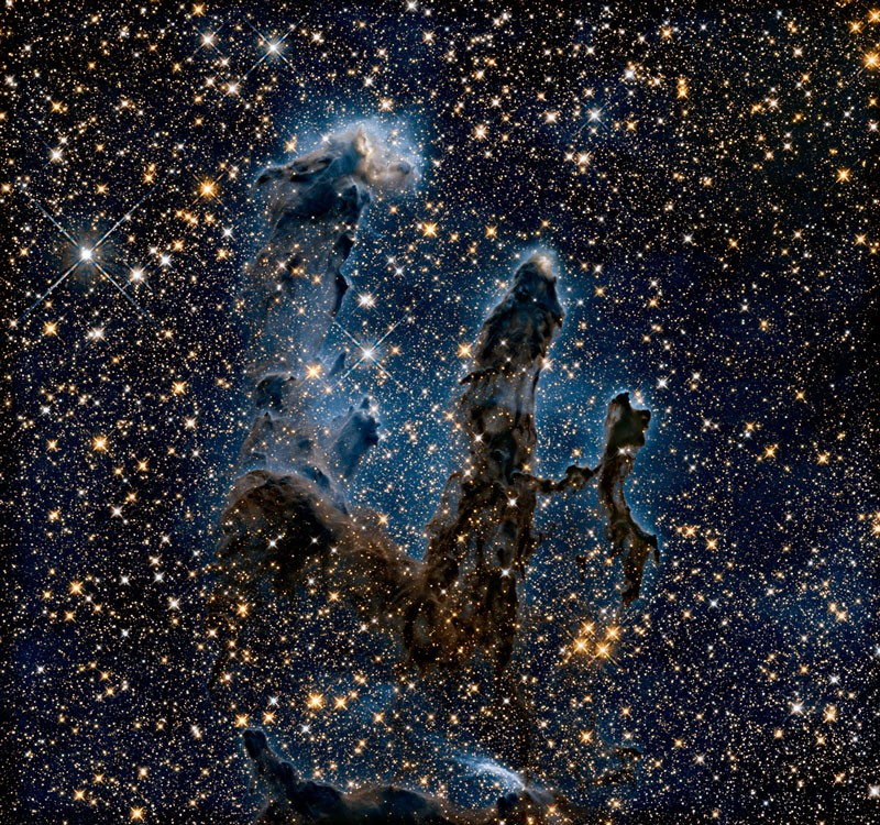 In this Hubble Space Telescope image, researchers revisited one of Hubble's most iconic and popular images: the Eagle Nebula's Pillars of Creation. Here, the pillars are seen in infrared light, which pierces through obscuring dust and gas and unveil a more unfamiliar — but just as amazing — view of the pillars.
