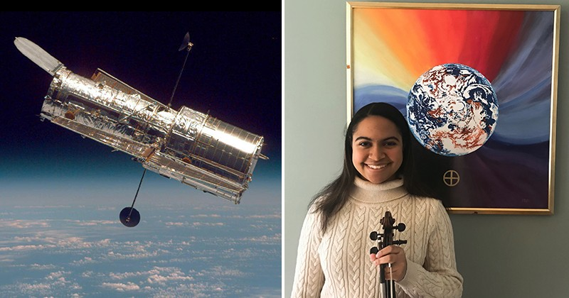 Leia Sofía Méndez, a first-year student at UD, composed a musical tribute to the Hubble Space Telescope, launched 30 years ago this month. She stands with her violin in front of a painting of Earth based on one of the Hubble's iconic images. The artist, Peter Reppert, is a former colleague of Méndez's father, who helped the Hubble locate its targets.