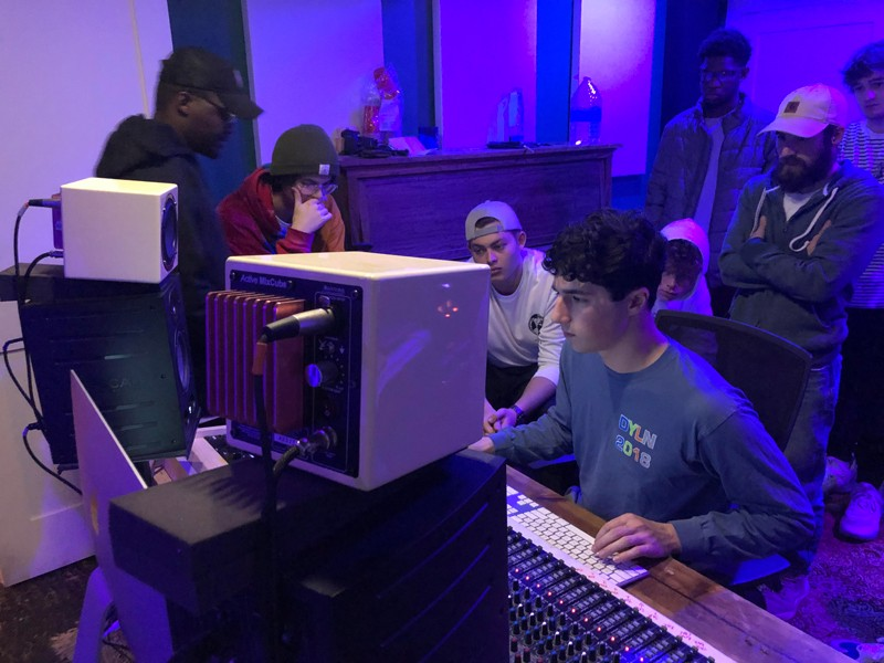 In October, before the coronavirus (COVID-19) pandemic created a need for social distancing, UD's Music Production Club visited the Occupy recording studio on Main Street in Newark, Delaware. Here, Julian Volare (seated at the computer) recorded vocals, while members learned how to mix these vocals with audio effects.