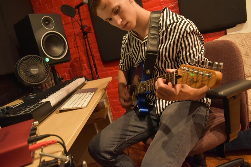 Samuel Goetz, president of the Music Production Club at the University of Delaware, plays guitar at Philadelphia's Grindhouse Multimedia Studio, where he formerly worked as an audio engineer, recording hip hop artists.