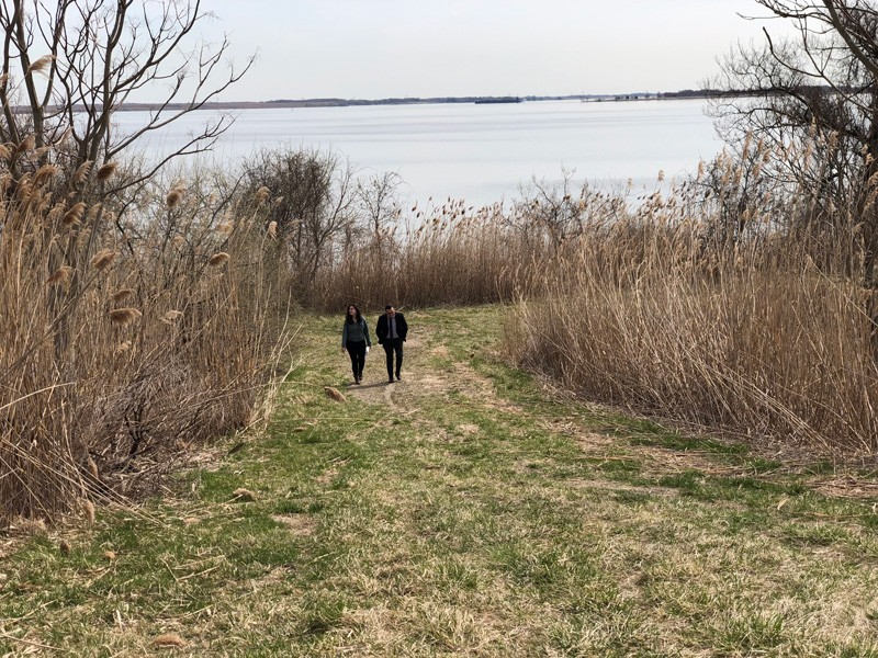 UD energy policy analyst and doctoral candidate Sara Parkison (left) walks with a representative of a wind turbine manufacturer to inspect a site in Delaware City for possible development as an offshore wind port.