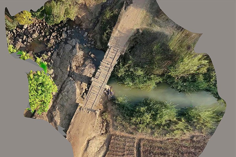 This aerial shot of a bridge in Malawi, Africa, shows problems with the planks and a significant need for repair. The University of Delaware chapter of Engineers Without Borders is partnering with the community to study the integrity of the bridge and develop repair options. Civil engineering major Drew Huffer is the project manager.