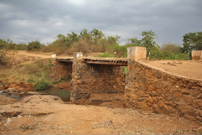 This image shows the full length of the community bridge in Malawi, Africa, that UD student Drew Huffer is studying. The bridge connects the community to a local market and hospital.